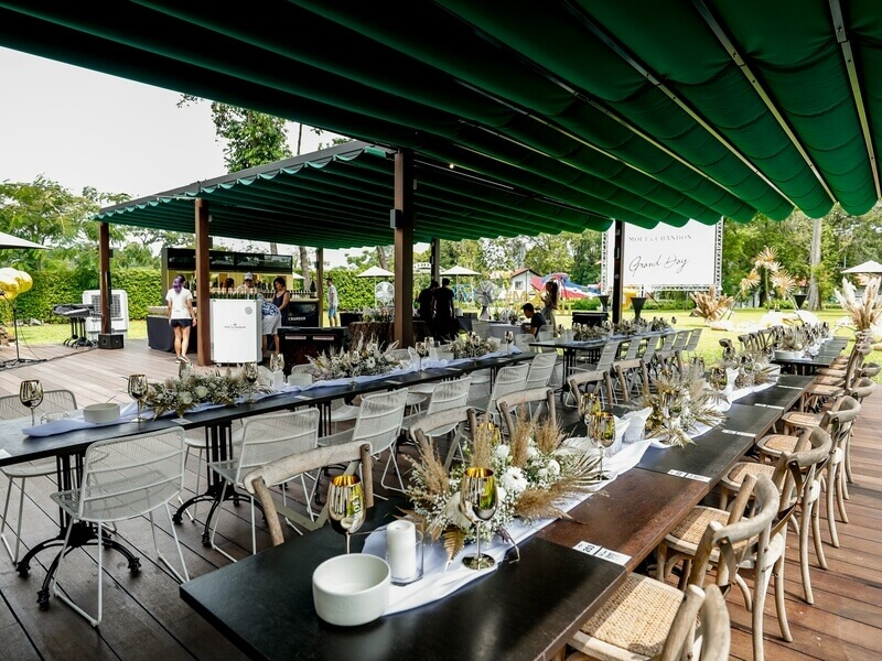 outdoor wedding seating with floral decorations on table
