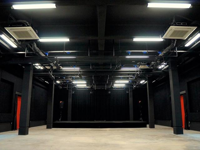 studio with black walls and pillars