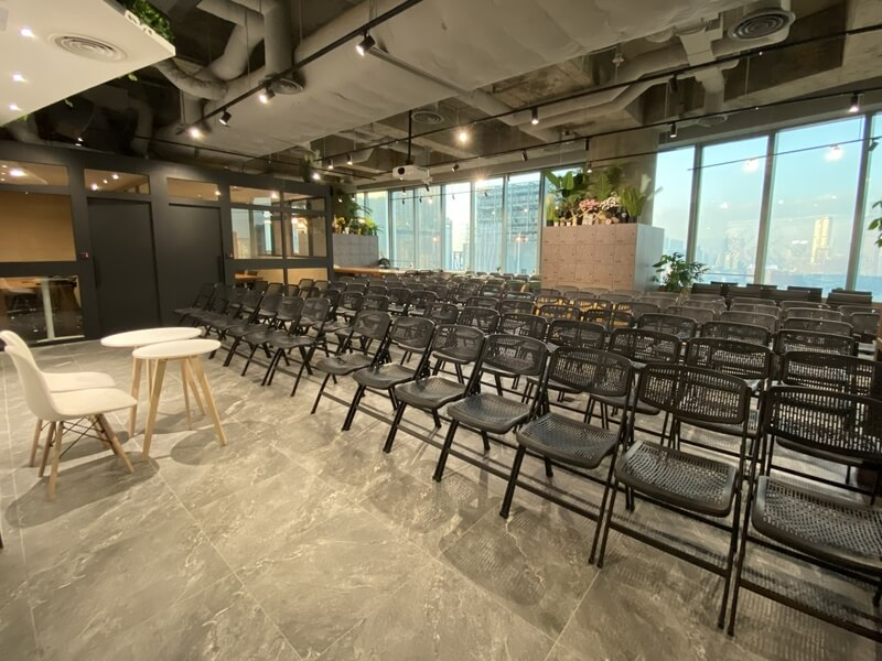 room filled with black chairs