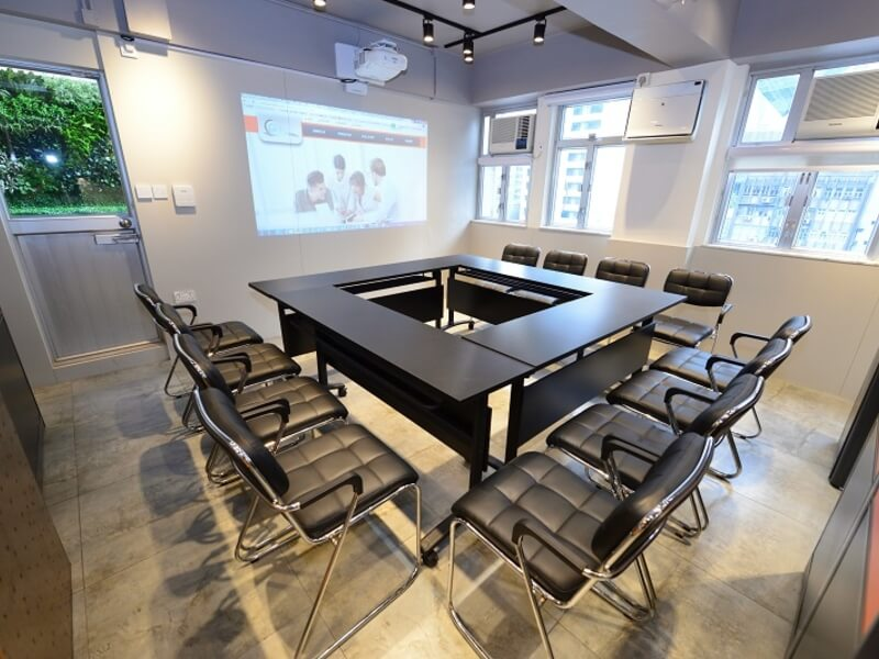 meeting room with black chairs and tables