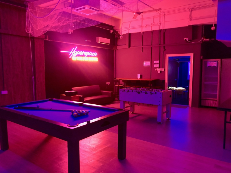 open space with pool table and foosball