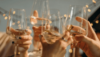 friends raising glasses up for a toast