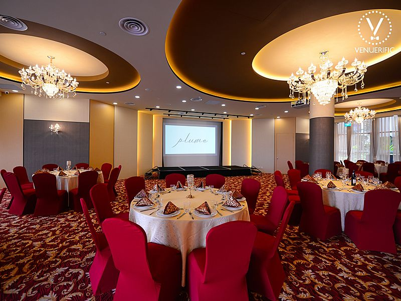 Red ballrooms with big chandeliers and table sections
