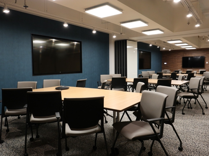 large meeting room with screens