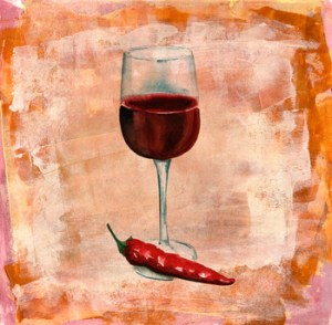 A glass of red wine with a red hot chili pepper