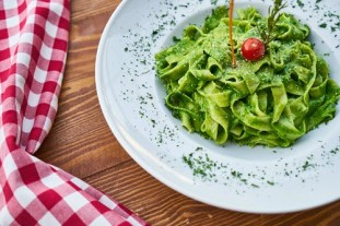 flat-pasta-noodle-with-green-sauce-dish-and-cherry-tomato-on-1435896