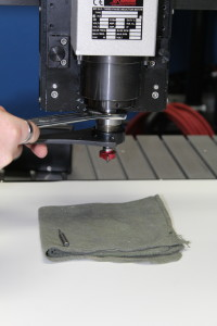 Cloth below router head to catch cutting tool