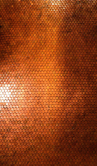 Copper floor made of recycled old coins - via Flickr