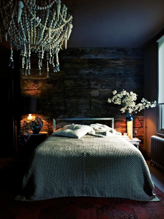 Dark walls and ceiling in this romantic bedroom with wooden bead chandelier  via VangViet