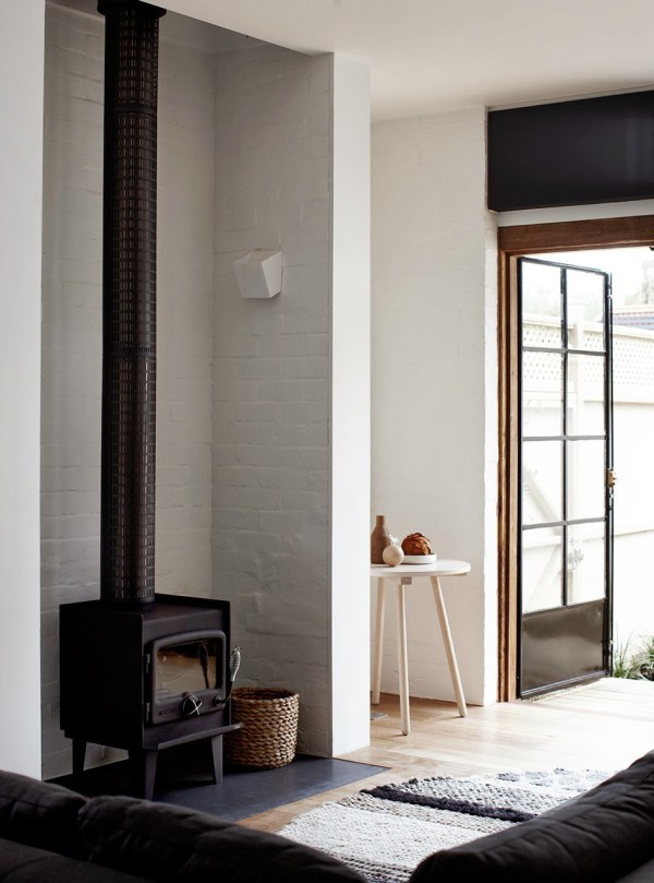 Wood stove in an Australian Barnhouse, Melbourne, designed by Whiting Architects