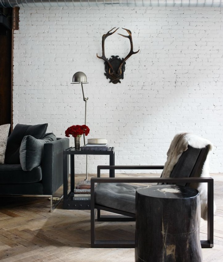 Vintage antlers in this bachelor loft designed by NY designer Jenny Wolf