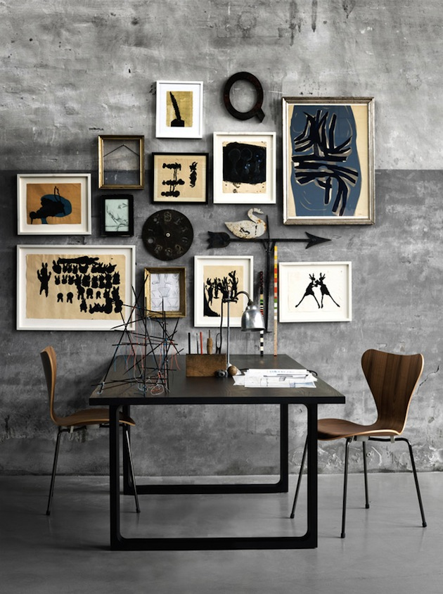 Bare concrete walls as a base for this gallery wall of contemporary art, which combine perfectly with the Mid Century Series 7 chiars by Arne Jacobson - via Inthralld