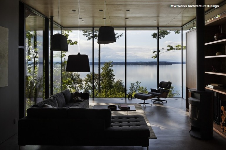 Concrete floor, mirroring the surface of the lake, in this contemporary cottage designed by MW Works Architecture and Design - via Houzz