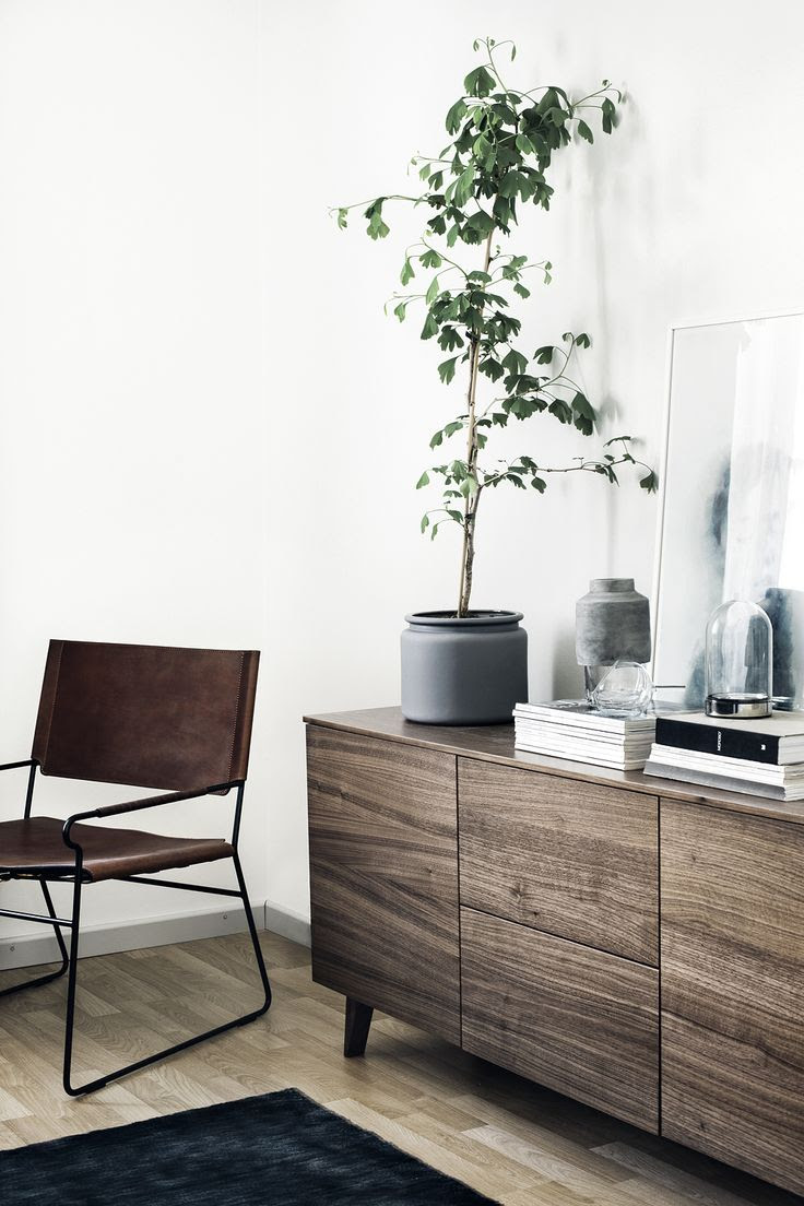 Simplicity examplified, this walnut sideboard in a Finnish home - via Coco Lapine