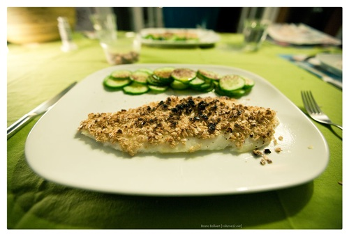 grilled fish topped with mustard and oats