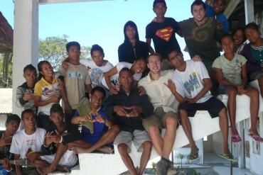 Posing with students East Timor min 1024x768 min I feel more of a global social responsibility to give back to society