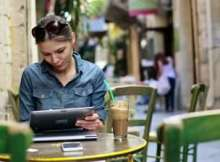 pretty-woman-with-tablet-computer-sitting-in-cafe