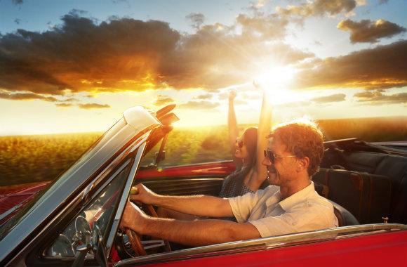 couple-driving-a-vintage-car-dp