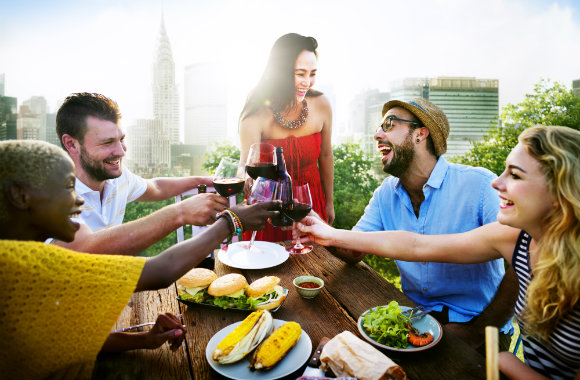 friends enjoying great food on a rooftop in new york