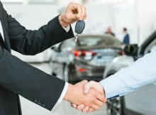 car-rental-company-congratulate-and-give-key-to-customer