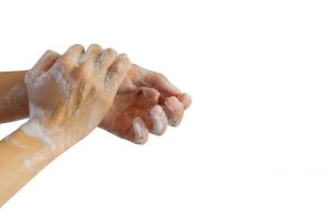 close up adult man washing and rubbing hand to cleaning soap isolated on white background for protection and prevent coronavirus (MERS-nCOV) and bacteria concept