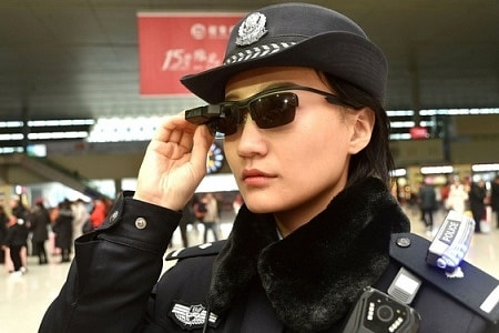 A female Chinese police officer during the Spring Festival Rush