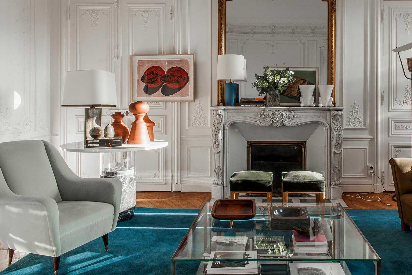 Living room with white painted panelling and a deep teal rug