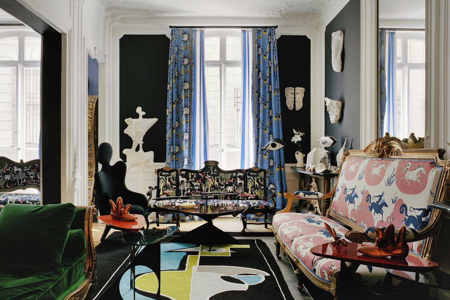 Living room in a Parisien-looking apartment mixing bold figurative and abstract designs