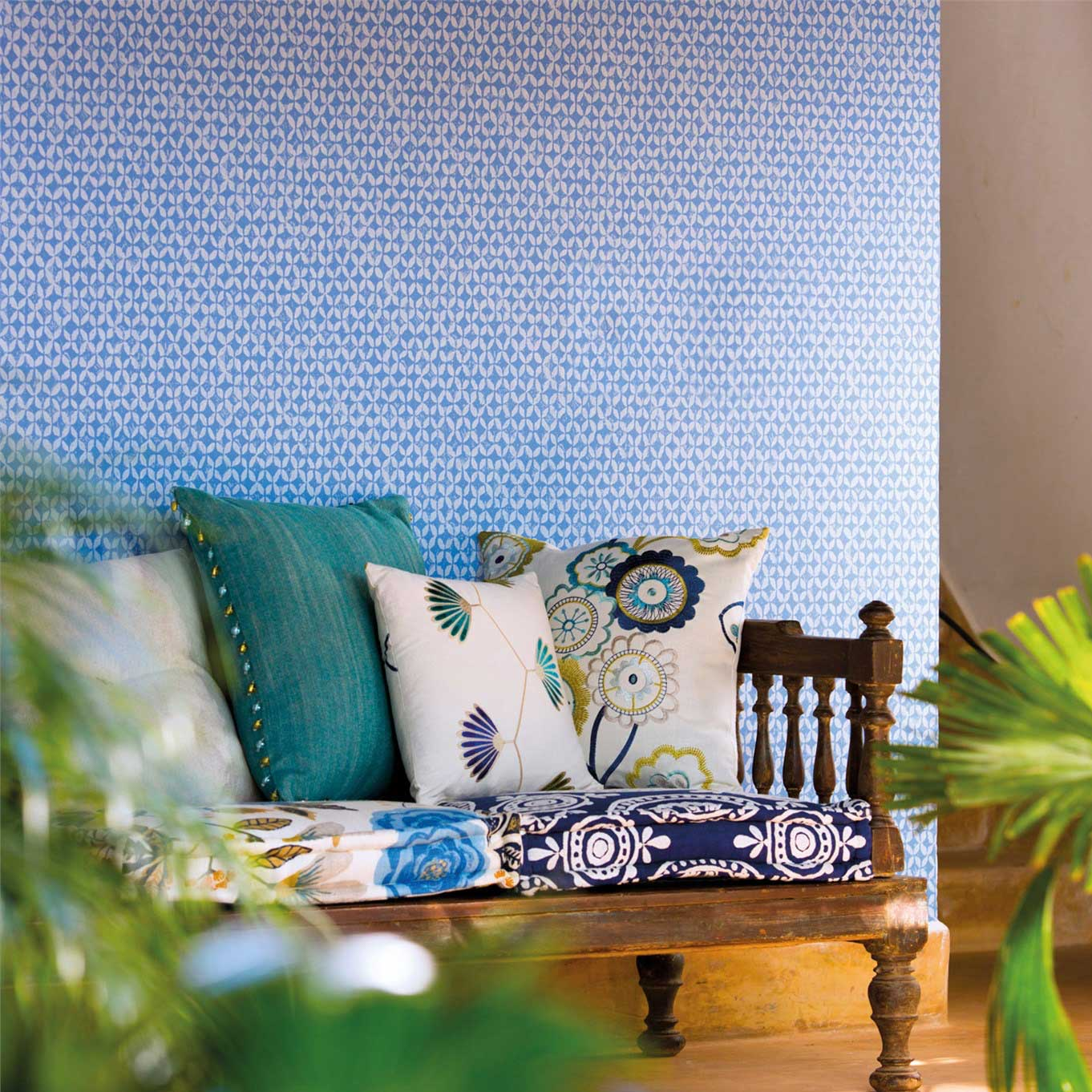 Living room with a blue tile effect wallpaper