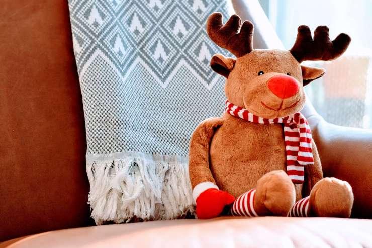 stuffed reindeer toy on chair