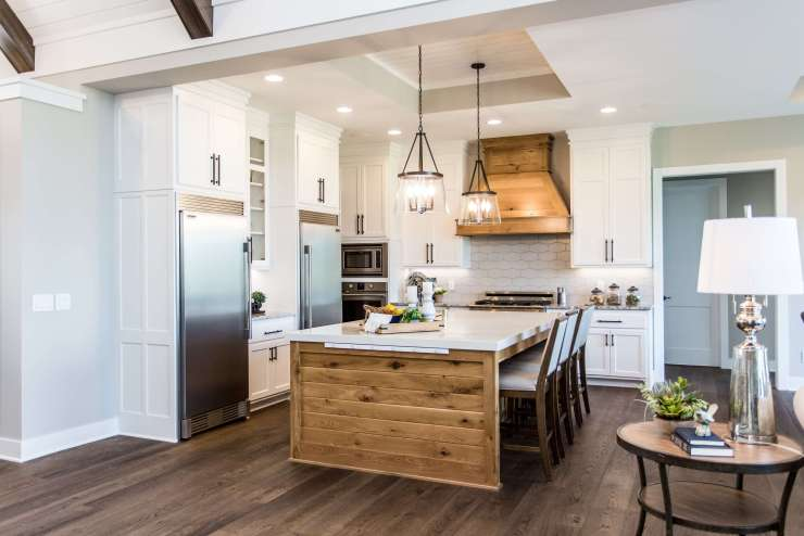 kitchen with white enamel cabinets and a white oak hood and island