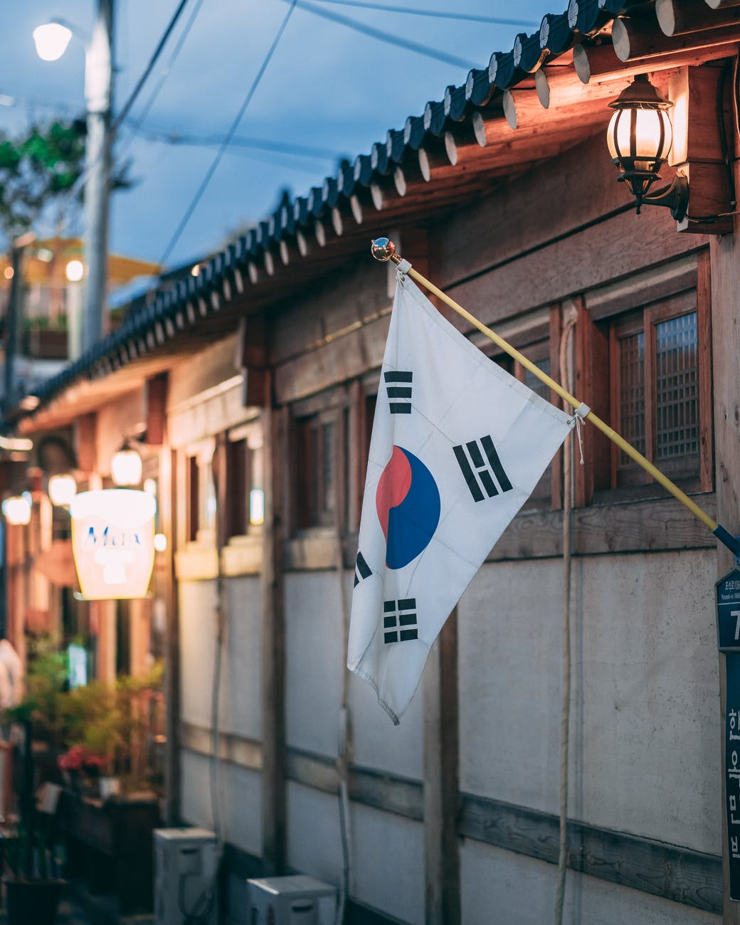 korean flag hanging outside a house