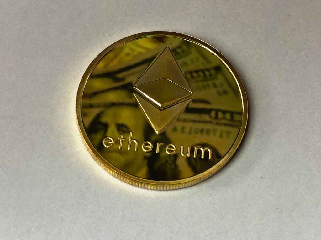 round gold colored ethereum ornament