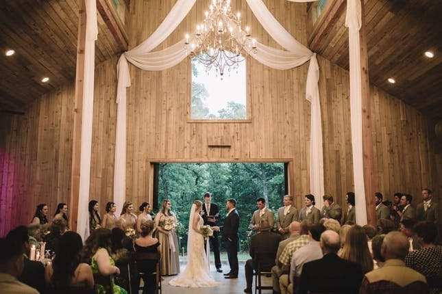 Image of the interior of the Whispering Oaks classical barn styled venue