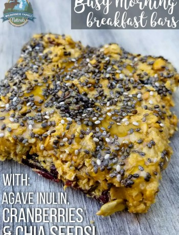 A honey nut chia inulin breakfast bar on a wooden table.
