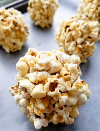 Salted Caramel Popcorn Balls | Gooey, sticky popcorn balls without corn syrup or a candy thermometer! Get the kids in the kitchen and make this delicious fall treat! | WildernessFamilyNaturals.com