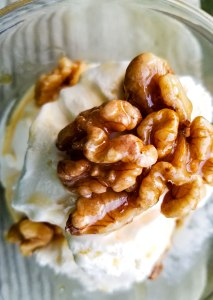 Sweet Walnut Dessert Drizzle | Do you know what makes desserts even better? If you answered more dessert on top of dessert, you would be correct! This homemade nut topping adds a maple-y caramel crunch to everything from ice cream to sweet potatoes to yogurt! | WildernessFamilyNaturals.com