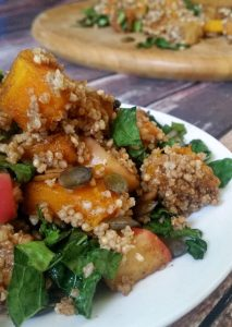 Baked Pumpkin-Apple Quinoa Salad | Here's a show-stealing side dish! Quinoa and pumpkin are a match made in heaven. With quinoa's natural nuttiness and pumpkin's natural sweetness, I think food babies are about to be conceived. Tying them together with apple is a smart move, too. | WildernessFamilyNaturals.com