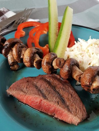 Paleo Italian-Marinated Steak & Mushrooms | Do you cringe at the thought of dumping steak sauce all over a perfectly grilled grass-fed steak? This Paleo Italian-marinated steak and mushrooms recipe is so flavorful no one will even think of reaching for the steak sauce! | WildernessFamilyNaturals.com