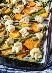 Garlic-Ginger-Lime Chicken & Sweet Potato Sheet Pan Dinner | What do you need on busy school nights when you just want to get a healthy dinner on the table in a hurry? This chicken and sweet potato sheet pan dinner is the answer! Mix and match your favorite veggies and enjoy the bright, fresh flavors without the chaos! | WildernessFamilyNaturals.com