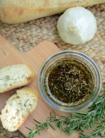 Roasted Garlic & Herb Olive Oil Dipping Sauce | You can easily replicate restaurants' olive oil dipping sauce at home! No need to reserve it as an accompaniment for bread. Drizzle this Roasted Garlic & Herb Olive Oil Dipping Sauce over salads, roasted vegetables, and meats for an extra burst of flavor. | WildlyOrganic.com