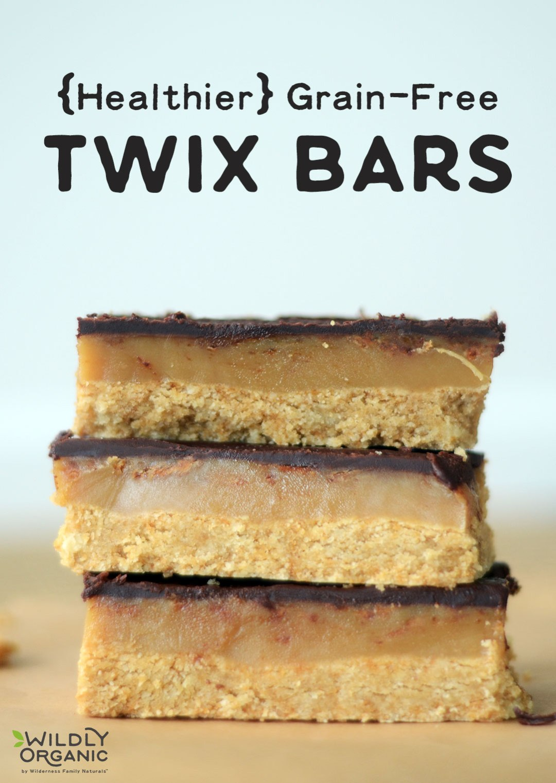 {Healthier} Grain-Free Twix Bars | Who can deny the delicious combination of chocolate, caramel, and cookie crust? It's mouth-watering! Satisfy the craving for candy bars with these healthier Grain-Free Twix Bars! They're free of refined sugar, too and have a dairy-free option! | WildlyOrganic.com