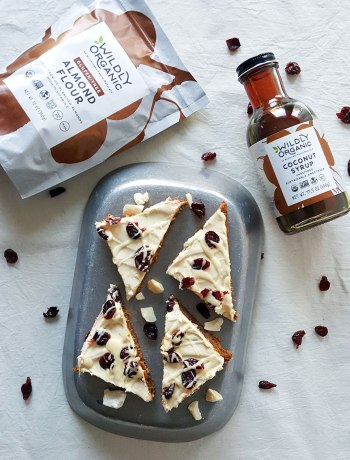 If you're craving the seasonal cranberry bars from a popular coffee chain (you know the one...), then you need to try these grain-free, gluten-free Blissful Holiday Cranberry Bars. Tart cranberries and sweet cream cheese, nestled atop a grain-free blondie and drizzled with white chocolate... what could be better?!
