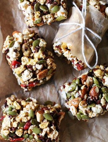 These Superfood Popcorn Bars are a cross between crispy puffed rice cereal treats and granola bars — but with the healthy twist of added superfoods. Perfect for any time you need a portable treat: school lunches, purse, diaper bag, picnics, road trips, and more!