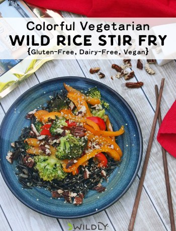 Photo of finished colorful stir fry | This colorful vegetarian wild rice stir fry dish takes under thirty minutes to make, making it ideal for a busy weeknight dinner and contains a host of awesome vitamins and fueling nutrients. While it is a vegan dish, feel free to top it with your favorite protein to give it a bit of a boost. Gluten-free, dairy-free, and egg-free too!