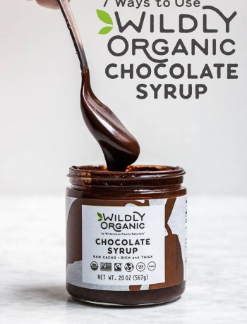 Photo of a jar of Wildly Organic Chocolate Syrup with a spoon above it dripping the fudge