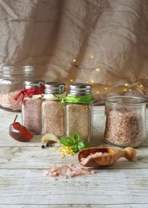 Photo of salt shakers filled with different seasoning salts