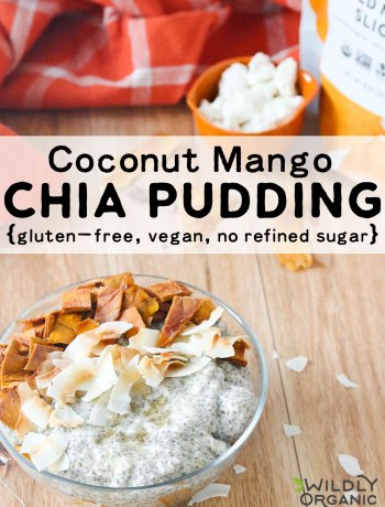 a bowl of coconut mango chia pudding topped with dried mango and toasted coconut flakes on a table