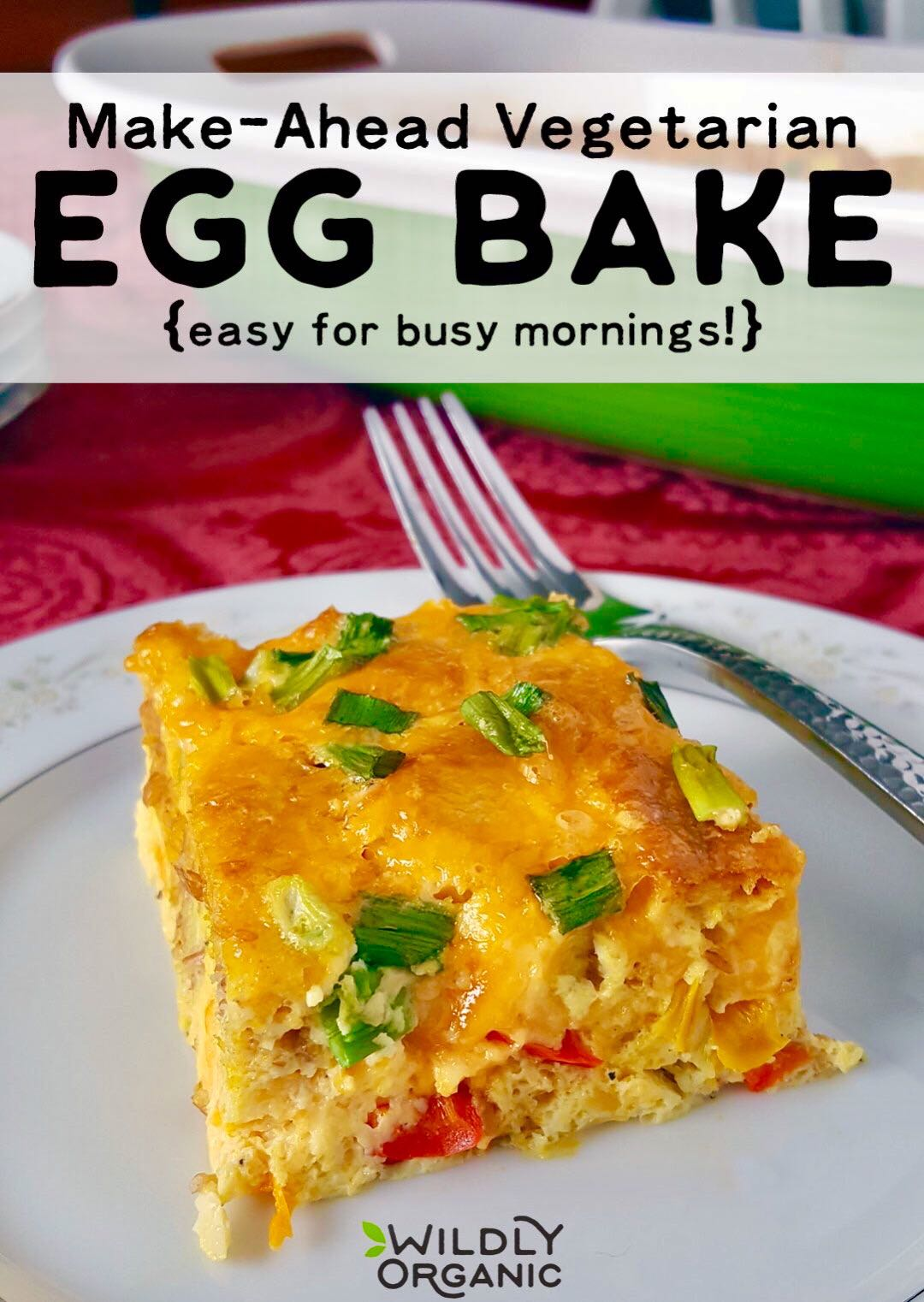 Photo of a slice of egg bake on a plate, with the casserole in the background.