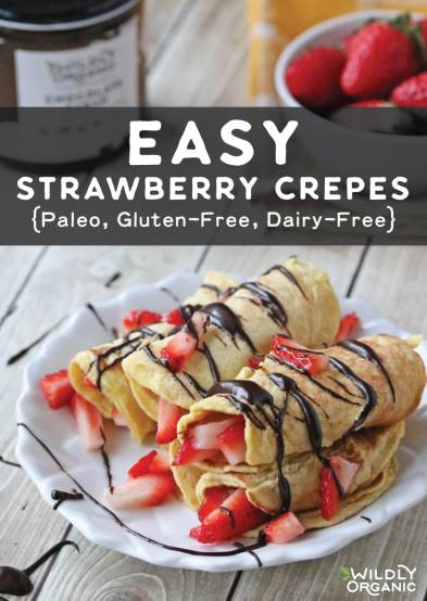 A photo of easy strawberry crepes drizzled with Wildly Organic Chocolate Sauce and chopped strawberries on a platter for morning brunch.